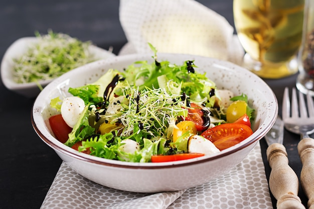 Vegetarian salad with cherry tomato, mozzarella and lettuce.