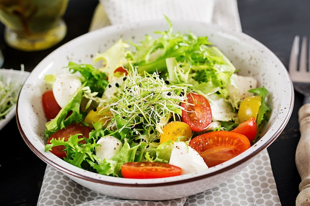 Vegetarian salad with cherry tomato, mozzarella and lettuce.