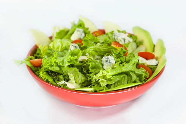 Vegetarian salad with tomatoes, cheese, lettuce and other ingredients. vegetables salad in the bowl.