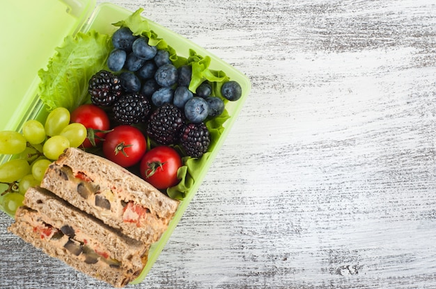 Vegetarian sandwich and berries