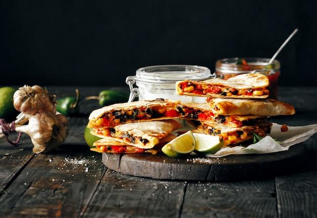 Vegetarian snacks quesadilla vegetables cheese dark