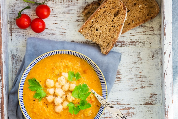 Vegetarian soup from carrots, tomatoes, brocolli and chickpeas