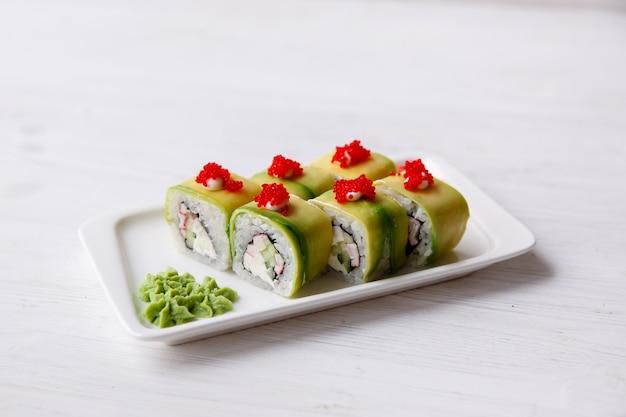 Vegetarian sushi avocado rolls with philadelphia cream cheese, sesame seeds, unagi sauce. sushi menu. japanese food.