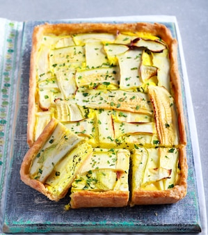 Vegetarian tart with cheese and spinach and zucchini top
