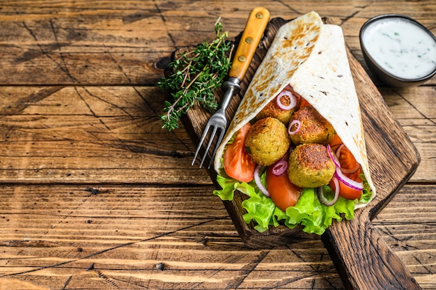 Vegetarian tortilla wrap with falafel and fresh salad, vegan tacos