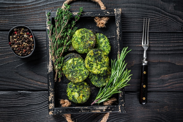 Vegetarian veggie vegetable falafel patty with herbs in a wooden tray