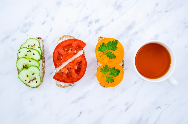 Veggan sandwiches with tea top view