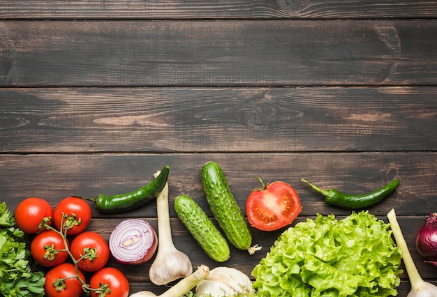 Veggies on copy space wooden background
