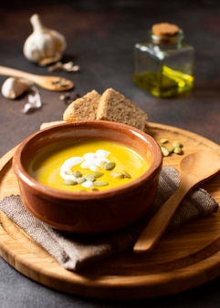 Veggies creme soup winter food on wooden board
