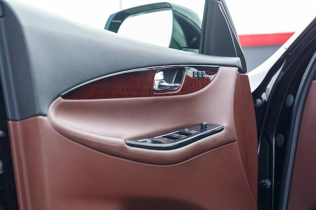 Vehicle interior. interior trim of car doors. brown leather car interior.