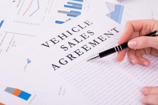 Vehicle sales agreement concept, documents on the desktop