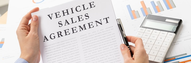 Vehicle sales agreement concept, documents on the desktop