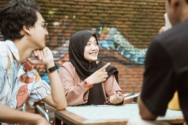 Veiled female students smile while chatting