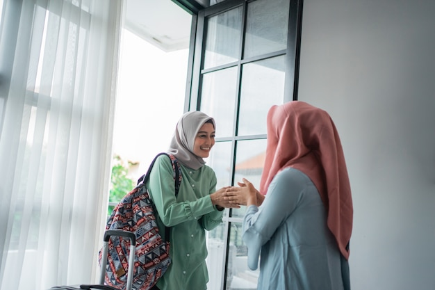 Veiled women greeting salam when meeting her friend