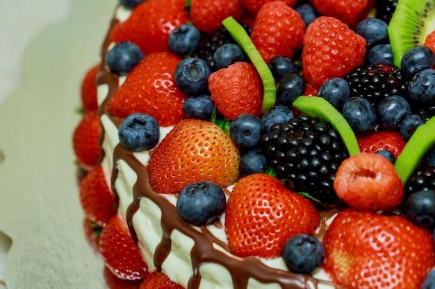 Velvet cake with beautiful berries strawberries, raspberries, blueberries