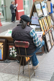Vendor selling paintings on street, santiago, santiago metropolitan region, chile