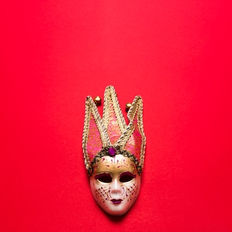 Venetian mask on red