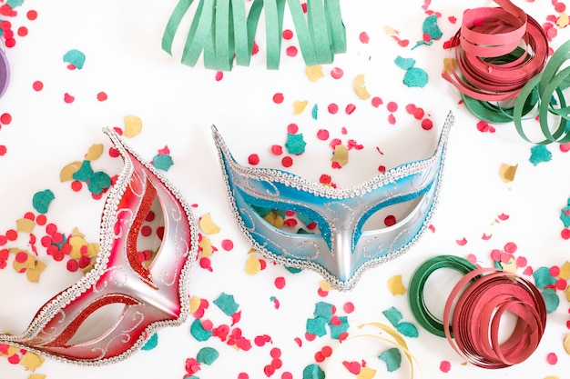Venetian masks with confetti