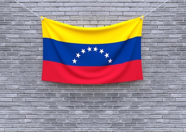 Venezuela flag hanging on brick wall