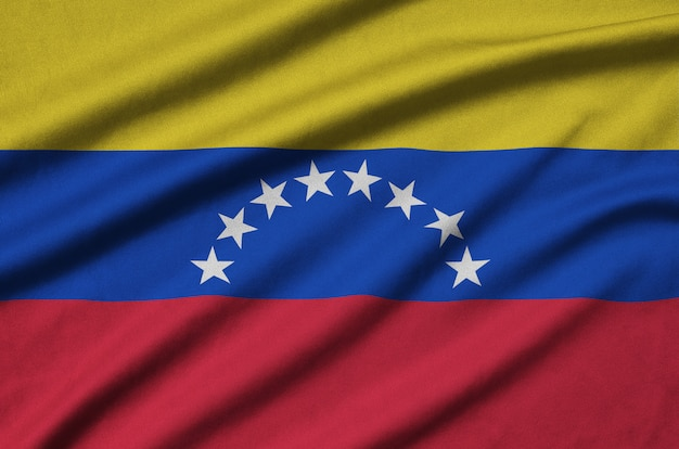 Venezuela flag  is depicted on a sports cloth fabric with many folds.
