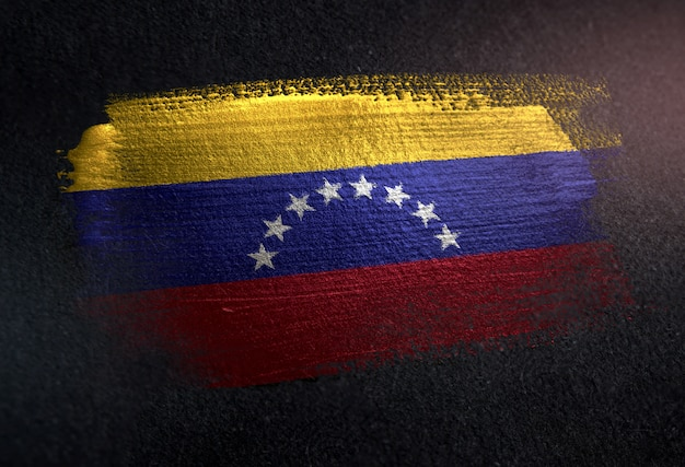 Venezuela flag made of metallic brush paint on grunge dark wall