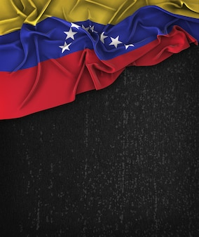 Venezuela flag vintage on a grunge black chalkboard with space for text