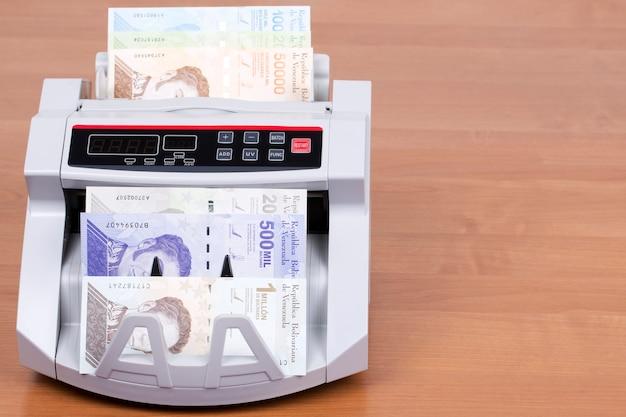 Venezuelan bolivar in a counting machine