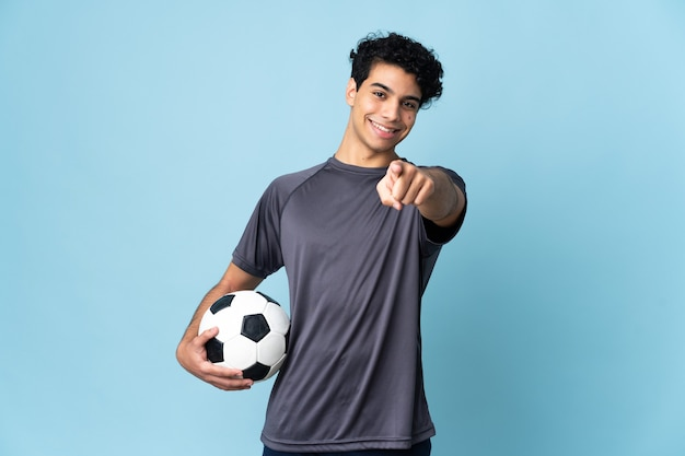 Venezuelan football player man pointing front with happy expression
