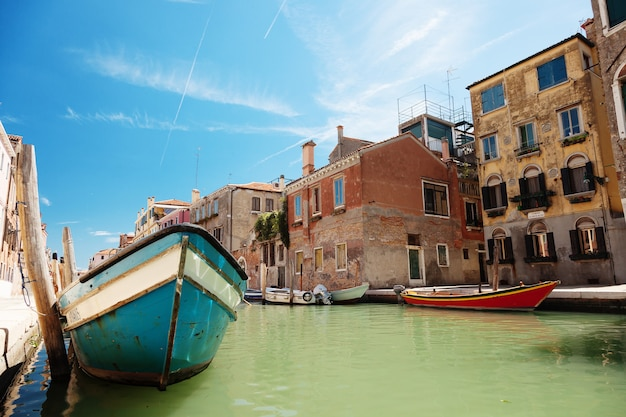 Venice canal, historic houses and boats, italy