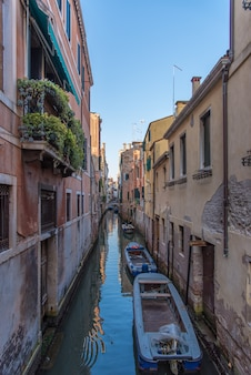 Venice canal with gondola boats