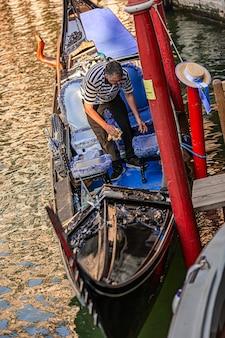 Venice, italy 2 july 2020: gondolier in venice