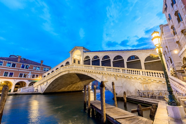 Venice, italy, rialto bridge and grand canal at twilight blue hour sunrise,