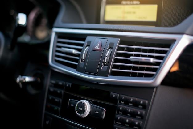 Ventilation grille on dashboard of modern car.