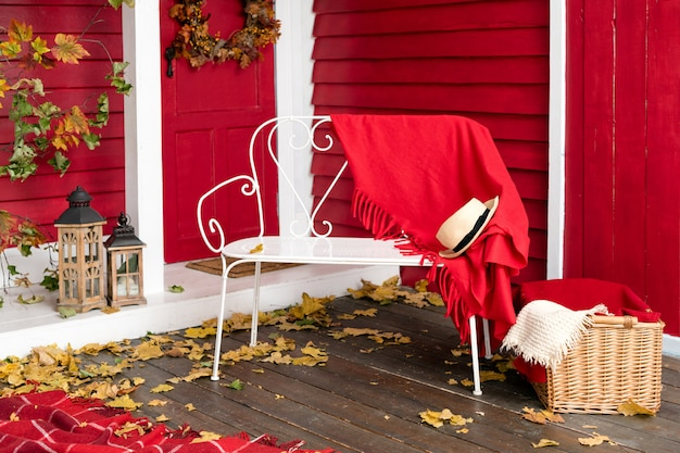 Veranda of countryside house in autumn leaves