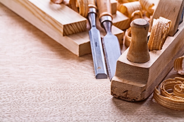 Veri close up view old fashioned plane chisels planks shavings