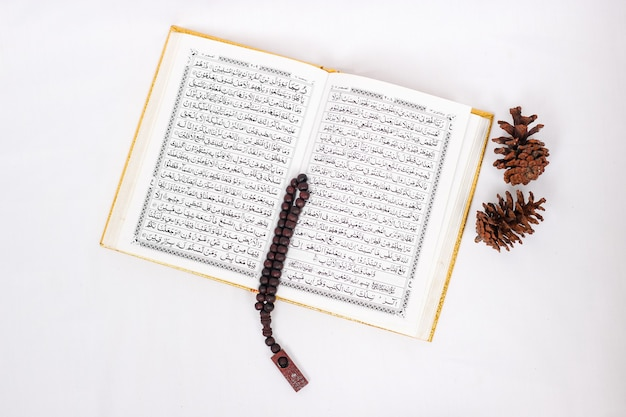 Verses of the holy quran and tasbih isolated on white background