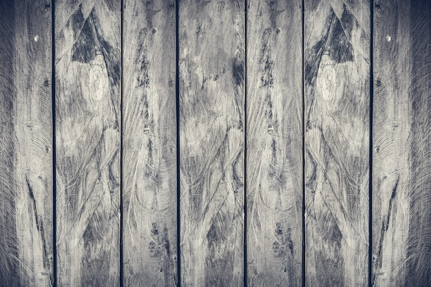 Vertical aliagnment wood plank texture background,dramatic grey tone filtered