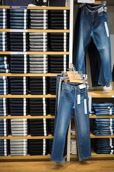Vertical angle with shelf of jeans and denim