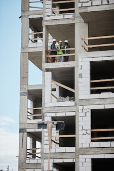 Vertical background image of high rise construction site copy space