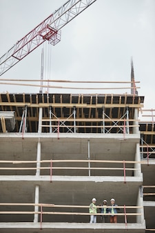 Vertical background shot of high rise construction site copy space