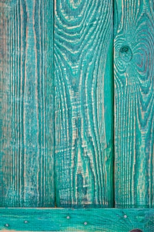 Vertical background of three green wooden texture boards fastened by a horizontal plank.