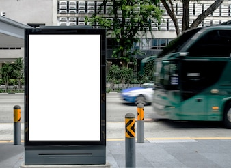 Vertical blank  billboard at bus stop outdoor advertise on street Mock up.