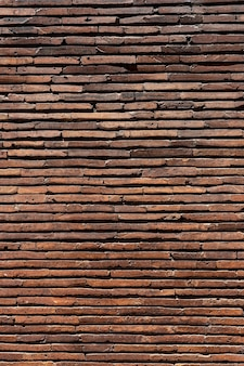 Vertical brown brick wall background