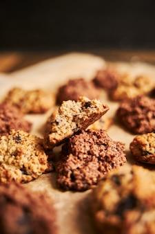 Vertical closeup shot of a bitten oatmeal cookie on a platter