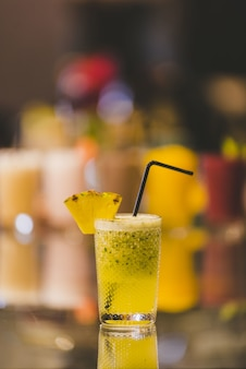 Vertical closeup shot of a non-alcoholic drink on blurred