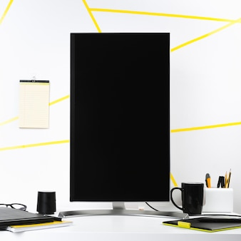 Vertical computer screen in office surroundings