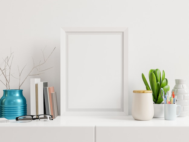 Vertical frame on table and white wall