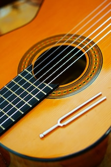 Vertical high angle closeup of the strings of a classical guitar