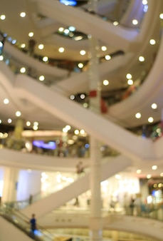 Vertical image of abstract blurred escalators inside a shopping mall