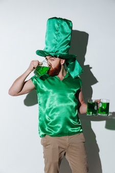 Vertical image of bearded man in green costume